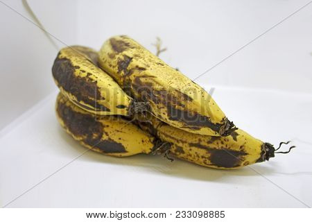 Bunch Of Extra Ripe Bananas On White Background