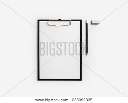 Clipboard With Blank Letterhead, Pencil And Eraser On White Paper Background. Stationery Mockup With