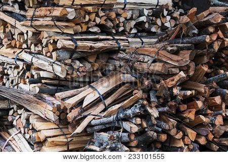 Firewood In Woodpile. Pile Of Firewood In Small Asian Village On Bali