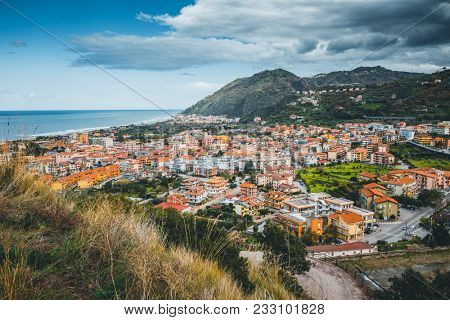 Wonderful view of of the Mediterranean resort town. Location Brolo city, Messina, Sicily island, Italy, Europe. Scenic image of beautiful spring landscape. Discover the beauty of earth.