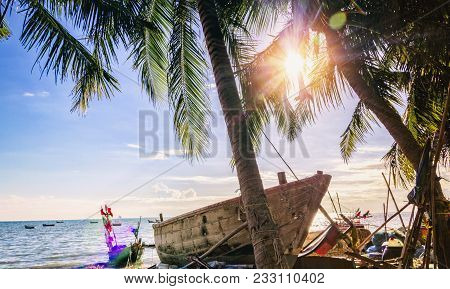 Tropical Beach With Coconut Trees And Fishing Boats