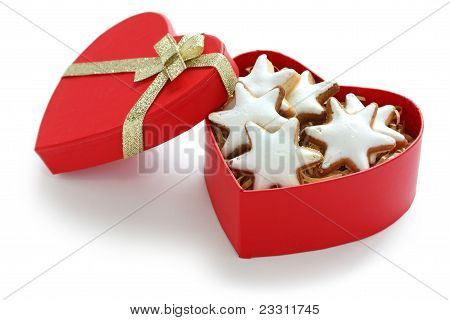 Zimtstern , homemade christmas cookies in a red heart shaped box poster