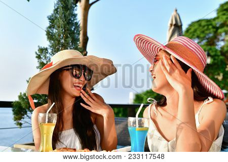 Travel Concepts. Beautiful Girl Is Eating At A Seaside Restaurant. Asian Girls Come To Relax At The