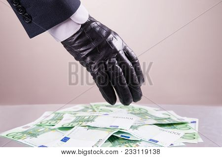 Hand In Black Glove Steals Money, Bribe And Corruption Concept, One Hundred Euro Banknotes