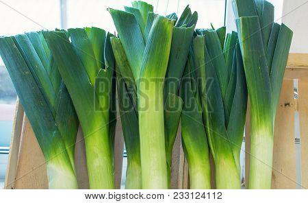 Leek In A Shop Window Selling Vegetables.