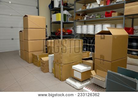 Small warehouse with cardboard boxes