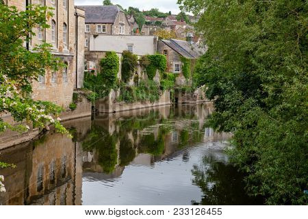 Old houses along the River Avon (Bristol Avon) in Bradford-on-Avon, a town and civil parish in West Wiltshire, Southwest England, UK