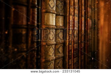 Antiquarian vintage books in old library, close-up.