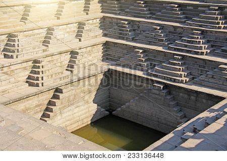 Stepped Tank With Green Water In Pushkarani, Hampi, Karnataka, India. Queens Bath. Background Geomet