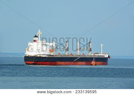 Pilot Assisting Bulk Cargo Ship To Harbor Quayside