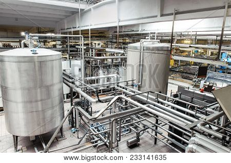 Interior Of Brewery Equipment. Manufacturing And Pasteurization Flash.