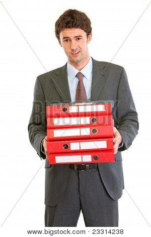Displeased Modern Businessman Holding Many Folders