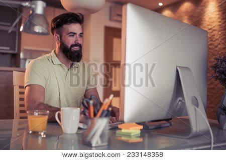Young Man Running Small Business From Home Office