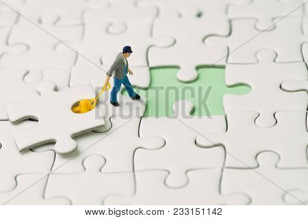 Fulfill The Missing Piece For Business Success Strategy Metaphor, Miniature Worker Figurine Using Th