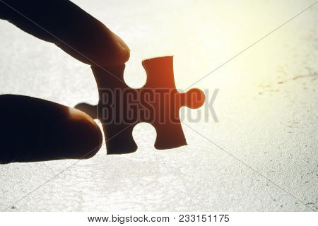 Business Strategy Missing Piece, Solution For Success Concept, Hand Holding A Paper Jigsaw Puzzle Pi