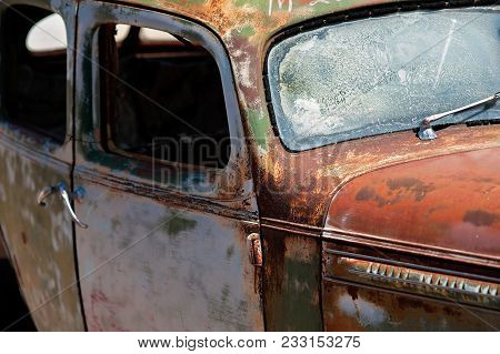 Close Up Of An Old, Antique, Rusted Out And Defunct Vehicle.