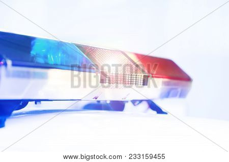 Red And Blue Light Flasher Of A Police Car. Siren On Police Car Flashing. Blue Flasher On The Police