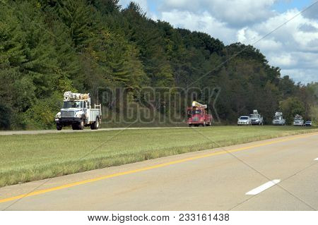 Numerous Electric Utility Trucks Of Multiple Electric Companies Heading South On The Interstate High
