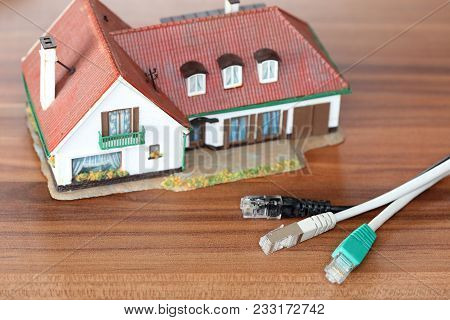 Symbolic Cable Connection With Plugs And House