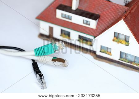 Symbolic Connection With Cable And House Model On White Background