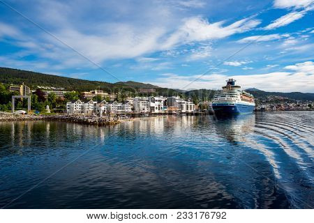 Molde in Romsdal, Norway. Molde has a maritime, temperate climate, with cool-to-warm summers, and relatively mild winters. The city is nicknamed The Town of Roses.