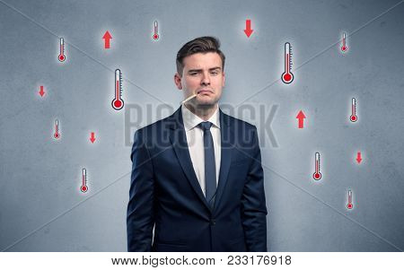 Young tired businessman with thermometer and fever concept