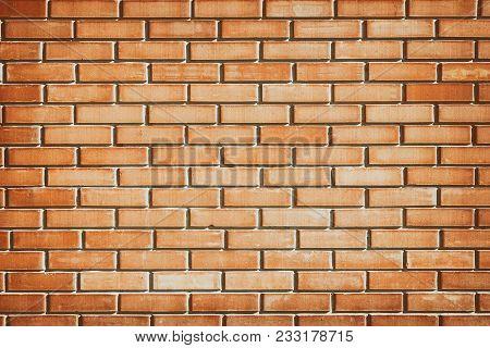 Orange Brick Wall Texture. Sunlit Brickwork. Grunge Urban Background