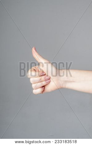The Man's Hand Shows A Gesture Of Approval. Thumbs Up. The Hand Shows Gesture Class. Everything Is C