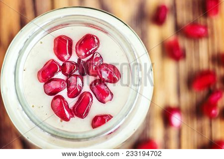 Fresh Plain Yogurt Smoothie Parfait With Juicy Pomegranate Seeds In A Glass Jars For Breakfast. Home