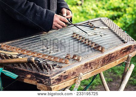Cimbalom Very Special String Wooden Musical Instrument. A Street Musician Plays A Cimbalom. The Cimb