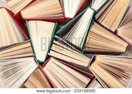 Top View Of Many Old Books. Used Hardback Books. View From Above. Education Background