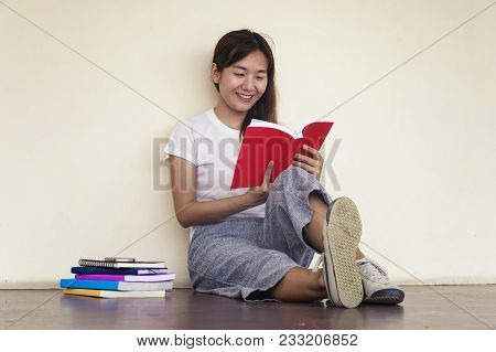 Beautiful Woman Of A Student Sitting With Laptop And Relaxing In The Garden. Education Concept.copy