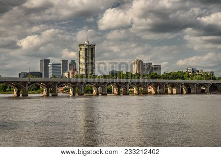 Skyline Of Tulsa, Oklahoma With Arkansas River In The Foreground