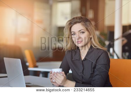 Portrait Of Cheerful Employer Of Business Enterprise Enjoying Creative Working Process In Modern Off