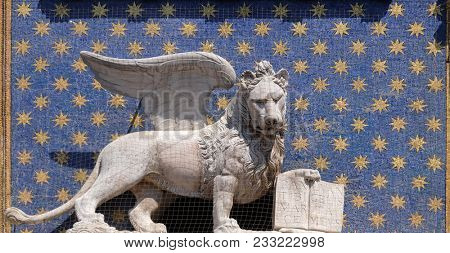 VENICE, ITALY - MAY 28 : The statue of the winged lion on the St Mark`s Clock tower Torre dell`Orologio on Piazza San Marco, Venice, Italy, UNESCO World Heritage Sites on May 28, 2017.