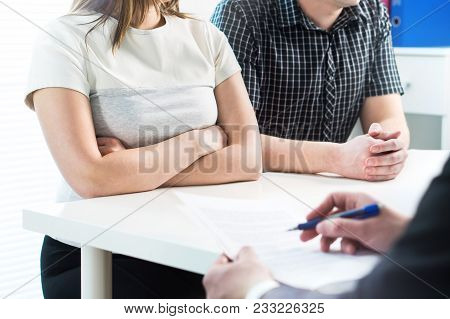 Unhappy Couple In Meeting With Therapist, Psychologist, Divorce Lawyer Or Legal Consultant. Upset Wo