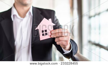 Architect, Banker, Realtor, Agent, Businessman Or Broker Holding Paper House. Real Estate Or Archite