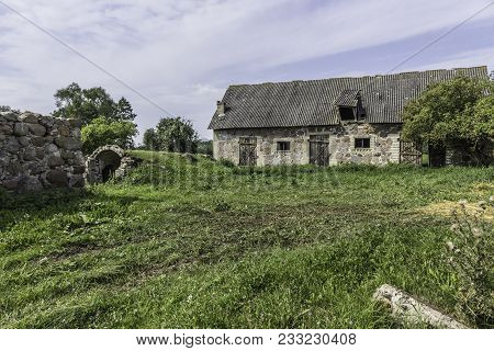The Farmyard Is An Agricultural Abandoned Farm. The Old Collapsed Barns. The End Of The Summer . Pod