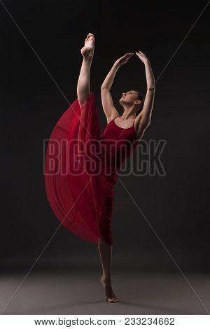 Beautiful Girl In Red Chiffon Dress Dancing Gracefully In Dark Room View