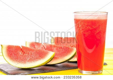Refreshing thirst quenching summer fruit drink. Pureed watermelon crush smoothie. Slices of watermelon and blended in glass against white background with copy space. poster