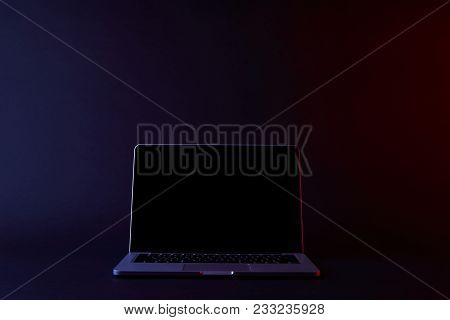 One Turned Off Laptop With Blank Screen On Dark