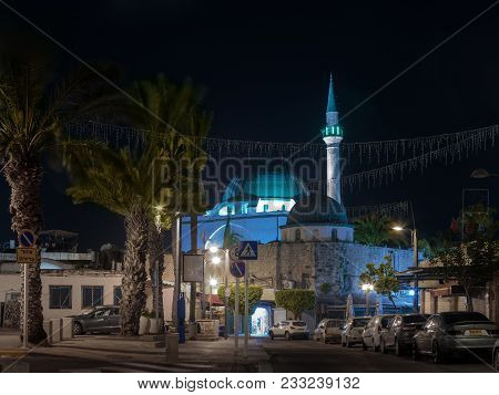 Acre, Israel, March 24, 2018 :  Night View Of Weizman Street And The Al-jazzar Mosque In The Old Cit