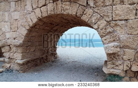 Remains Of The Ancient Roman Aqueduct On The Mediterranean Coast Near The Caesarea City In Israel