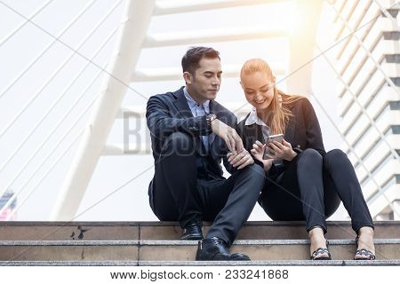 Two Businesspeople Looking On Phone With Happily And Funny, Relax And Lifestyle In Freetime