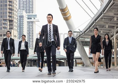 Teamwork And Professional Partnership Concept, Businesspeople Team Of Multi Ethnic Walking  With Con