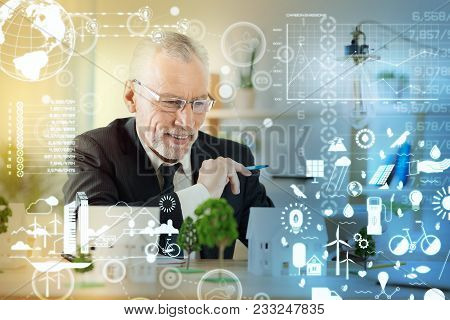 Happy Engineer. Optimistic Enthusiastic Mature Engineer Feeling Confident And Smiling While Looking