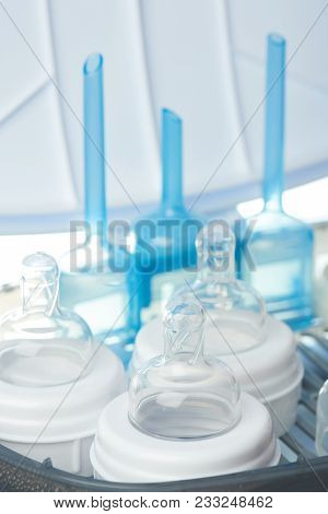 Milk Bottles Sterilizing Theme. Cleaning Nipple From Bacteria