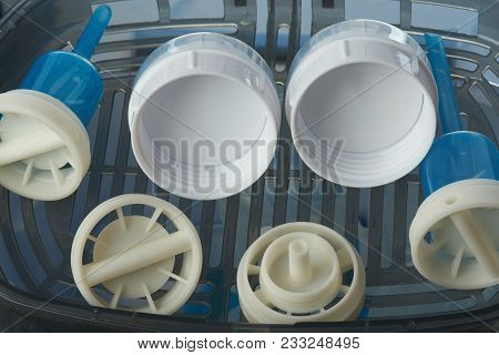 Clean Caps For Plastic Feeding Bottles In Sterilizer Tray