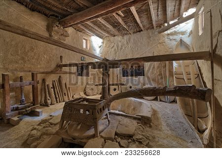 Cairo, Egypt - March 24 2018: Ancient Rotary Flour Mill Used To Be Rotated By Animal Power At The Mo