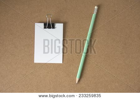 White Paper Message Note With Pencil On Cork Board